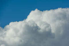 White fluffy clouds in blue sky. Close up detail of white clouds in the bright blue sky Stock Photos