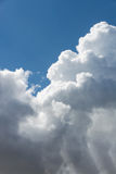 White fluffy clouds in blue sky. Close up detail of white clouds in the bright blue sky Royalty Free Stock Photography