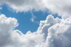 White fluffy clouds in blue sky. Close up detail of white clouds in the bright blue sky Stock Image