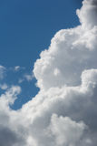 White fluffy clouds in blue sky. Close up detail of white clouds in the bright blue sky Stock Photography