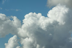 White fluffy clouds in blue sky. Close up detail of white clouds in the bright blue sky Stock Images