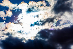 White fluffy clouds in the blue sky. Dramatic cloudscape with su Royalty Free Stock Photography