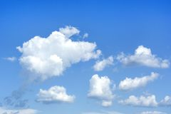 White fluffy clouds and blue sky. Nature weather background. And pattern. Cumulus clouds type stock photo