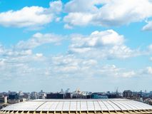 White fluffy clouds in blue sky over Moscow city. View from observation deck on Sparrow Hills (Vorobyovy Gory) - white fluffy clouds in blue sky over Moscow city royalty free stock image