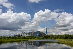White fluffy clouds in the blue sky and Power plant background.  royalty free stock photos