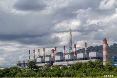 White fluffy clouds in the blue sky and Power plant background.  stock photography