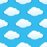 White fluffy clouds in a blue sky seamless pattern. White fluffy clouds in a sunny blue summer sky seamless background pattern with repeat motifs in square Stock Photos