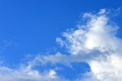 White fluffy clouds in blue sky Stock Photo