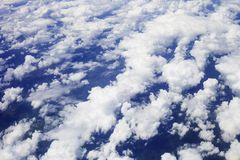 White fluffy clouds in blue sky, top view stock image