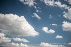 White and fluffy clouds in the blue sky stock photography