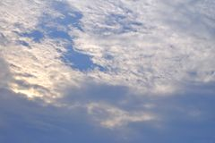White fluffy clouds in bright day. Against blue sky  for background texture royalty free stock images
