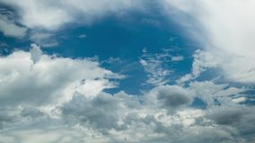 White fluffy clouds moving in the sunny blue sky. In the rural of Thailand stock video footage