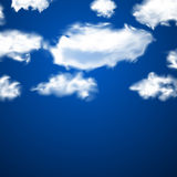 White fluffy clouds over blue. Stock Image