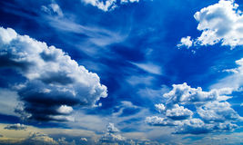 White fluffy clouds over blue sky. Royalty Free Stock Photography