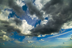 White fluffy clouds over blue sky. Stock Image