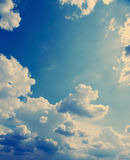 White fluffy clouds over blue sky. Stock Photos