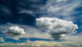 White fluffy clouds over blue sky Royalty Free Stock Images