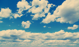 White fluffy clouds over blue sky. Stock Photography