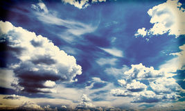 White fluffy clouds over blue sky, filtered image instagram effect. Stock Images
