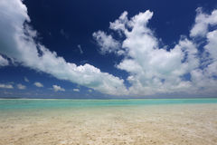 White fluffy clouds over turquoise lagoon water Stock Photography