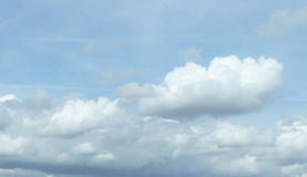 White Fluffy Clouds in a Pale Blue Sky stock photo
