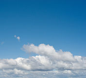 White fluffy clouds in the sky Stock Image