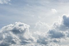 White fluffy clouds in the sky Stock Photography