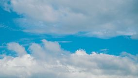 White fluffy clouds. Time lapse clip of white fluffy clouds over blue sky stock video