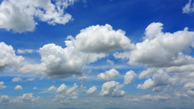 White fluffy cloudy above summer sky Stock Images