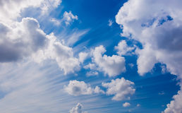 White fluffy cumulus clouds on a blue sky Royalty Free Stock Photos