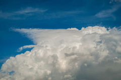 White fluffy Cumulus clouds on a blue sky Stock Photo