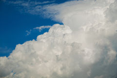White fluffy Cumulus clouds on a blue sky Royalty Free Stock Photography