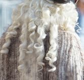 White fluffy fur on wig as background.  Stock Image