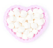White Fluffy mini Marshmallow in heart shape on white background Royalty Free Stock Photography