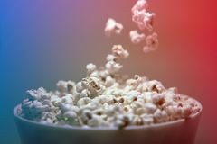 Popcorn falling in a bowl on a 3D effect background royalty free stock photos