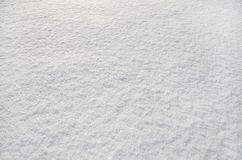 White fluffy snow like a background stock image