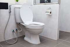 White flush toilet in modern bathroom Royalty Free Stock Image
