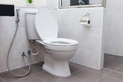 White flush toilet in modern bathroom royalty free stock image
