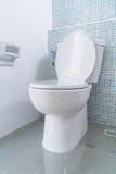 White flush toilet in modern bathroom. Interior Royalty Free Stock Photos