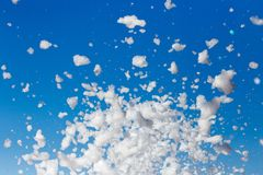 White foam against the blue sky as background stock image