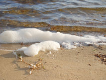 White foam on the beach Royalty Free Stock Photography