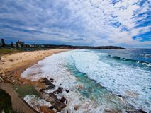 Pacific Ocean Waves at Bondi Beach, Sydney, Australia. White foam from breaking Pacific Ocean waves along yellow sand Bondi Beach, Sydney, NSW, Australia, with stock images