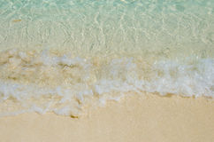 White foam made by ocean waves background Royalty Free Stock Photos