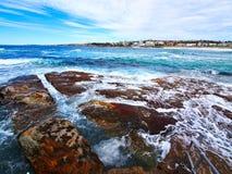 Pacific Ocean Waves on Bondi Beach, Sydney, Australia. White foam pacific Ocean waves washing along yellow sand on the Northern end of Bondi Beach, Sydney, NSW stock photo