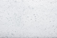 Soap foam. White foam from soap over white background Royalty Free Stock Photography