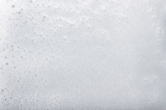 Soap foam with space for text. White foam from soap over white background with space for text Royalty Free Stock Photos