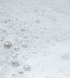 White foam with some bubbles. White foam with some bubbles Royalty Free Stock Photo