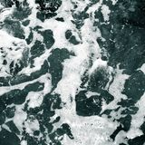 White foam on the surface of crystal clear sea water Royalty Free Stock Photo