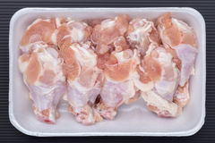 A white foam tray of raw chicken drumsticks from supermarket, fr. Esh food ingredients concept royalty free stock images