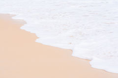 The white foam of wave on the sand Royalty Free Stock Photography